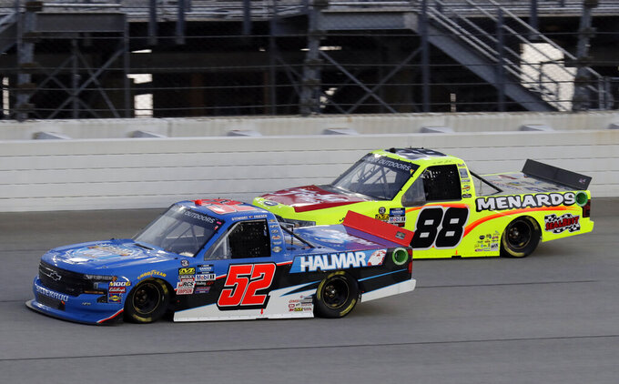 Stewart Friesen (52) drives past Matt Crafton duringa NASCAR Truck Series auto race at Chicagoland Speedway in Joliet, Ill., Friday, June 28, 2019. (AP Photo/Nam Y. Huh)