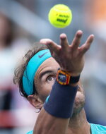 Rafael Nadal of Spain tosses the ball to serve to Daniel Evans of Britain during the Rogers Cup men's tennis tournament Wednesday, Aug. 7, 2019, in Montreal. (Paul Chiasson/The Canadian Press via AP)