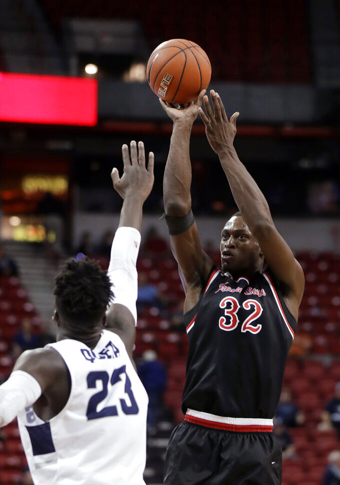 Fresno State's Nate Grimes (32) shoots as Utah State's Neemias Queta defends during the second half of an NCAA college basketball game in the Mountain West Conference men's tournament Friday, March 15, 2019, in Las Vegas. (AP Photo/Isaac Brekken)
