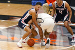 Gonzaga guard Jalen Suggs, left, and Pacific guard Pierre Crockrell II, right, scramble for the ball during the first half of an NCAA college basketball game in Stockton, Calif., Thursday, Feb. 4, 2021. (AP Photo/Rich Pedroncelli)
