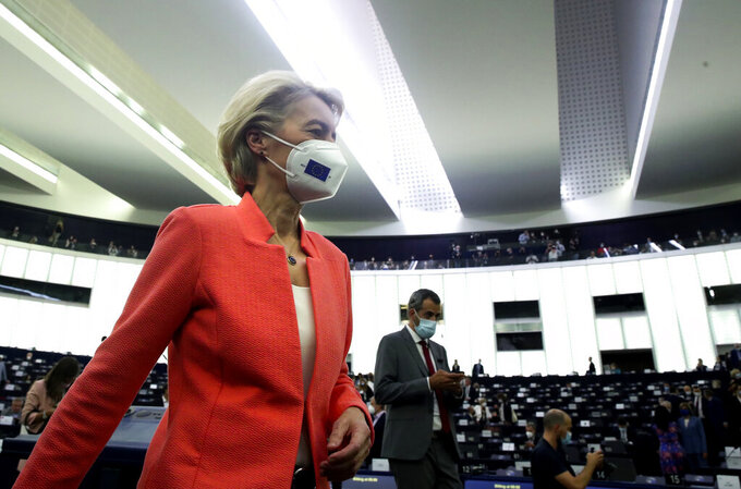 European Commission President Ursula von der Leyen walks in the chamber prior to delivering a State of the Union Address at the European Parliament in Strasbourg, France, Wednesday, Sept. 15, 2021. The European Union announced Wednesday it is committing 200 million more coronavirus vaccine doses to Africa to help curb the COVID-19 pandemic on a global scale. (Yves Herman, Pool via AP)