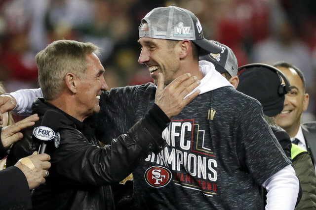 San Francisco 49ers head coach Kyle Shanahan celebrates with his dad, Mike, after the NFL NFC Championship football game against the Green Bay Packers Sunday, Jan. 19, 2020, in Santa Clara, Calif. The 49ers won 37-20 to advance to Super Bowl 54 against the Kansas City Chiefs. (AP Photo/Matt York)