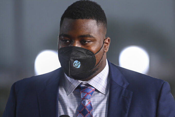 Alabama defensive lineman Christian Barmore appears on the red carpet at the Rock & Roll Hall of Fame before the NFL football draft Thursday, April 29, 2021, in Cleveland. (AP Photo/David Dermer, Pool)