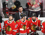 Chicago Blackhawks head coach Jeremy Colliton, center, watches play during the second period of an NHL hockey game against the Carolina Hurricanes Thursday, Nov. 8, 2018, in Chicago. (AP Photo/David Banks)