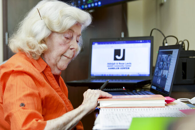 """Trudy Berlin, who hosts a weekly Zoom session at the Levis Jewish Community Center, works in Boca Raton, Fla., Tuesday, March 16, 2021. During the coronavirus pandemic, Berlin moved her in-person classes to Zoom. She's grown a steady audience of about 50 women from the U.S. and Canada who have come to view the class as a support group. Berlin says it's """"a whole new world out there"""" and she's having fun. (AP Photo/Cody Jackson)"""