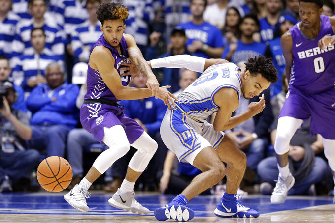 Central Arkansas guard DeAndre Jones, left, and Duke guard Tre Jones (3) chase the ball during the half of an NCAA college basketball game in Durham, N.C., Tuesday, Nov. 12, 2019. (AP Photo/Gerry Broome)