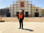 The Rev. Alex Chavez poses in front of the St. Charles Borromeo Catholic Church construction site in Visalia, Calif., on Thursday, Aug. 26, 2021. Chavez says the large-scale parish — which has been years in the making — is necessary to address the Catholic population boom in a region where, like much of the world, there is a dire shortage of priests. (Alejandra Molina/RNS via AP)