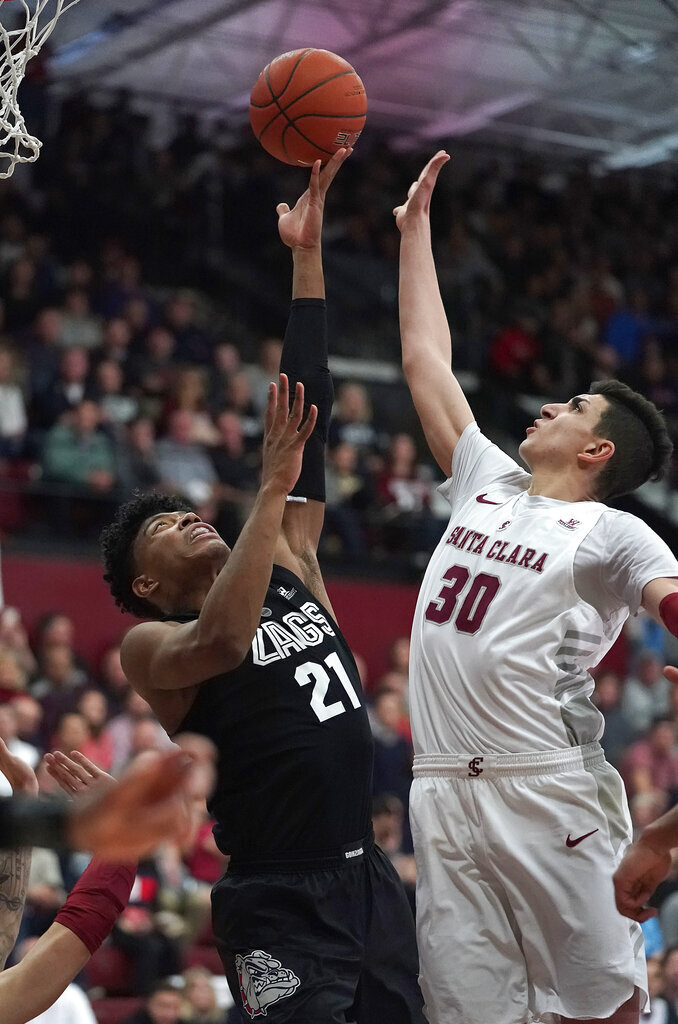 Gonzaga forward Rui Hachimura (21) shoots over Santa Clara forward Guglielmo Caruso (30) during the second half of an NCAA college basketball game Thursday, Jan. 24, 2019, in Santa Clara, Calif. Gonzaga won 98-39. (AP Photo/Tony Avelar)