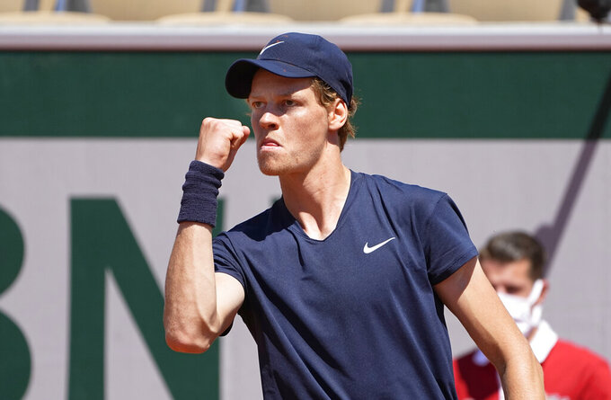 Italy's Jannik Sinner pcelebrates after winning a point against Pierre-Hugues Herbert of France during their first round match on day two of the French Open tennis tournament at Roland Garros in Paris, France, Monday, May 31, 2021. (AP Photo/Michel Euler)