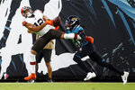 Jacksonville Jaguars cornerback Sidney Jones, right, breaks up a pass intended for Cleveland Browns wide receiver KhaDarel Hodge (12) during the first half of an NFL preseason football game, Saturday, Aug. 14, 2021, in Jacksonville, Fla. (AP Photo/Stephen B. Morton)