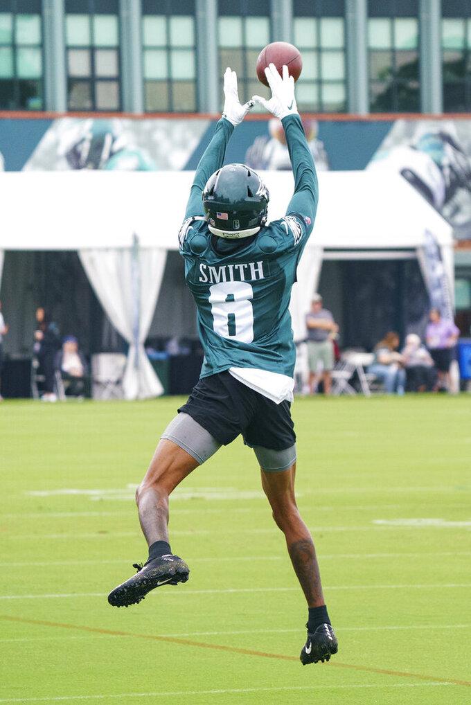 Philadelphia Eagles wide receiver DeVonta Smith leaps for the ball during practice at NFL football training camp, Thursday, July 29, 2021, in Philadelphia. (AP Photo/Chris Szagola)