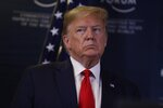 US President Donald Trump joins a news conference at the World Economic Forum in Davos, Switzerland, Wednesday, Jan. 22, 2020. Trump's two-day stay in Davos is a test of his ability to balance anger over being impeached with a desire to project leadership on the world stage. (AP Photo/Evan Vucci)