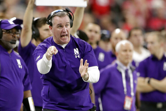 FILE - In this Dec. 1, 2018, file photo, Northwestern head coach Pat Fitzgerald directs his team from the sidelines during the second half of the Big Ten championship NCAA college football game against Ohio State in Indianapolis. Northwestern hopes to get some payback against Michigan State. The Wildcats will have their opportunity Friday night when they open at home against the Spartans in what they hope kicks off a run toward their third Big Ten West championship in four years. (AP Photo/Michael Conroy, File)