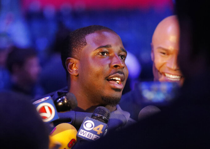 New England Patriots' Sony Michel answers a question during Opening Night for the NFL Super Bowl 53 football game Monday, Jan. 28, 2019, in Atlanta. (AP Photo/John Bazemore)