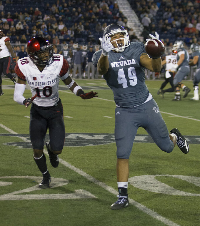 Nevada receiver Trae Carter-Wells (49) cannot make the catch against San Diego State in the first half of an NCAA college football game in Reno, Nev., Saturday, Oct. 27, 2018. (AP Photo/Tom R. Smedes)
