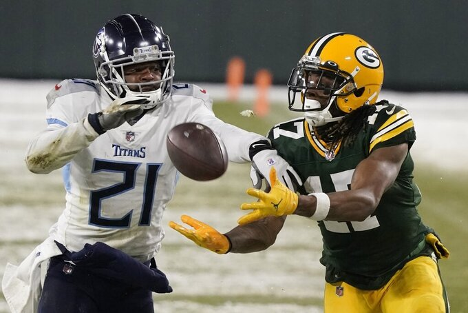 Green Bay Packers' Davante Adams catches a pass in front of Tennessee Titans' Malcolm Butler during the second half of an NFL football game Sunday, Dec. 27, 2020, in Green Bay, Wis. (AP Photo/Morry Gash)