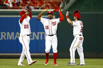 Washington Nationals outfielders Juan Soto, from left, Victor Robles and Adam Eaton celebrate after a baseball game against the New York Mets, Wednesday, May 15, 2019, in Washington. Washington won 5-1. (AP Photo/Patrick Semansky)
