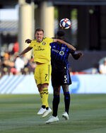 Columbus Crew's Pedro Santos, left, attempts a header against Montreal Impact's Zakaria Diallo during the first half of an MLS soccer match, Saturday, July 20, 2019, in Columbus, Ohio. (AP Photo/Aaron Doster)