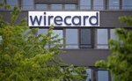 In this Friday June 19, 2020 photo, the Wirecard pictured at the headquarters of the payment service provider in Aschheim, Germany. Germany payment service provider Wirecard AG says it has concluded that two accounts that were supposed to contain 1.9 billion euros (2.1 billion dollars) probably don't exist. (Sven Hoppe/dpa via AP)