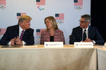 President Donald Trump speaks during a briefing with the U.S. Olympic and Paralympic Committee and Los Angeles 2028 organizers, Tuesday, Feb. 18, 2020, in Beverly Hills, Calif. From left, Trump, CEO of the United States Olympic and Paralympic Committee Sarah Hirshland, and LA 2028 Committee Chairman Casey Wasserman. (AP Photo/Evan Vucci)