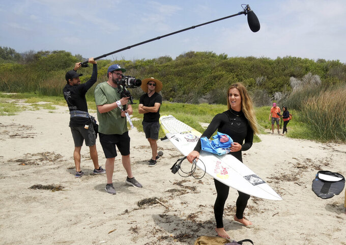 Surfer Caroline Marks of team USA is followed by tv crews during a Olympic exhibition a the USA Surfing Junior championships at the Lower Trestles in San Clemente on Tuesday, June 22, 2021. (Keith Birmingham/The Orange County Register via AP)