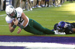 Baylor quarterback Charlie Brewer (12) dives across the goal line to score a touchdown as TCU safety Trevon Moehrig (7) goes to the ground during the second overtime of an NCAA college football game, Saturday, Nov. 9, 2019, in Fort Worth, Texas. Baylor won 29-23 in triple overtime. (AP Photo/Ron Jenkins)