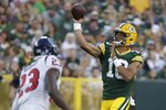Green Bay Packers' Jordan Love throws during the first half of a preseason NFL football game against the Houston Texans Saturday, Aug. 14, 2021, in Green Bay, Wis. (AP Photo/Mike Roemer)