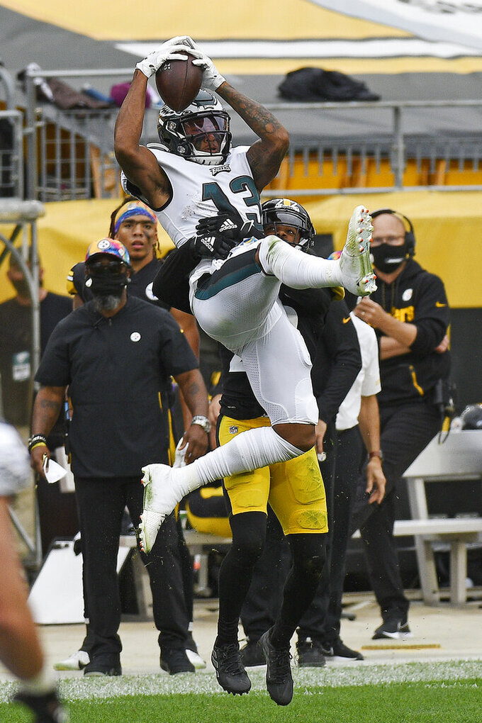 Philadelphia Eagles wide receiver Travis Fulgham (13) makes a catch with Pittsburgh Steelers cornerback Steven Nelson (22) defending during the second half of an NFL football game in Pittsburgh, Sunday, Oct. 11, 2020. (AP Photo/Don Wright)