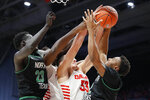 North Texas' Roosevelt Smart, right, battles for a rebound against Dayton's Ryan Mikesell (33) during the second half of an NCAA college basketball game, Tuesday, Dec. 17, 2019, in Dayton, Ohio. (AP Photo/John Minchillo)