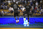 New York Yankees' Didi Gregorius, left, and Cameron Maybin celebrate after the Yankees defeated the Los Angeles Dodgers 10-2 in a baseball game, Friday, Aug. 23, 2019, in Los Angeles. (AP Photo/Mark J. Terrill)