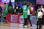 Boston Celtics' Tacko Fall (99) holds his hands on his head as the Celtics fall to the Toronto Raptors in the second half of an NBA conference semifinal playoff basketball game Thursday, Sept 3, 2020, in Lake Buena Vista Fla. (AP Photo/Mark J. Terrill)