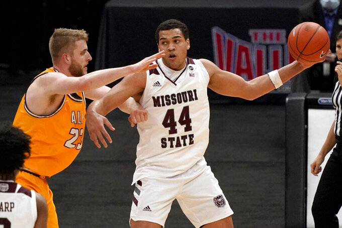 Missouri State's Gaige Prim (44) holds the ball as Valparaiso's Ben Krikke (23) defends during the second half of an NCAA college basketball game in the quarterfinal round of the Missouri Valley Conference men's tournament Friday, March 5, 2021, in St. Louis. (AP Photo/Jeff Roberson)