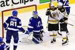 Boston Bruins left wing Brad Marchand (63) celebrates with center Patrice Bergeron (37) after scoring on Tampa Bay Lightning goaltender Andrei Vasilevskiy (88) as Lightning defenseman Erik Cernak (81) watches during the second period of Game 2 of an NHL hockey second-round playoff series, Tuesday, Aug. 25, 2020, in Toronto. (Frank Gunn/The Canadian Press via AP)