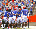 Florida players celebrate with teammate Kadarius Toney (1) who scored a touchdown on a punt return during an NCAA college football game against Kentucky in Gainesville, Fla. Nov. 28, 2020. (Brad McClenny/The Gainesville Sun via AP)