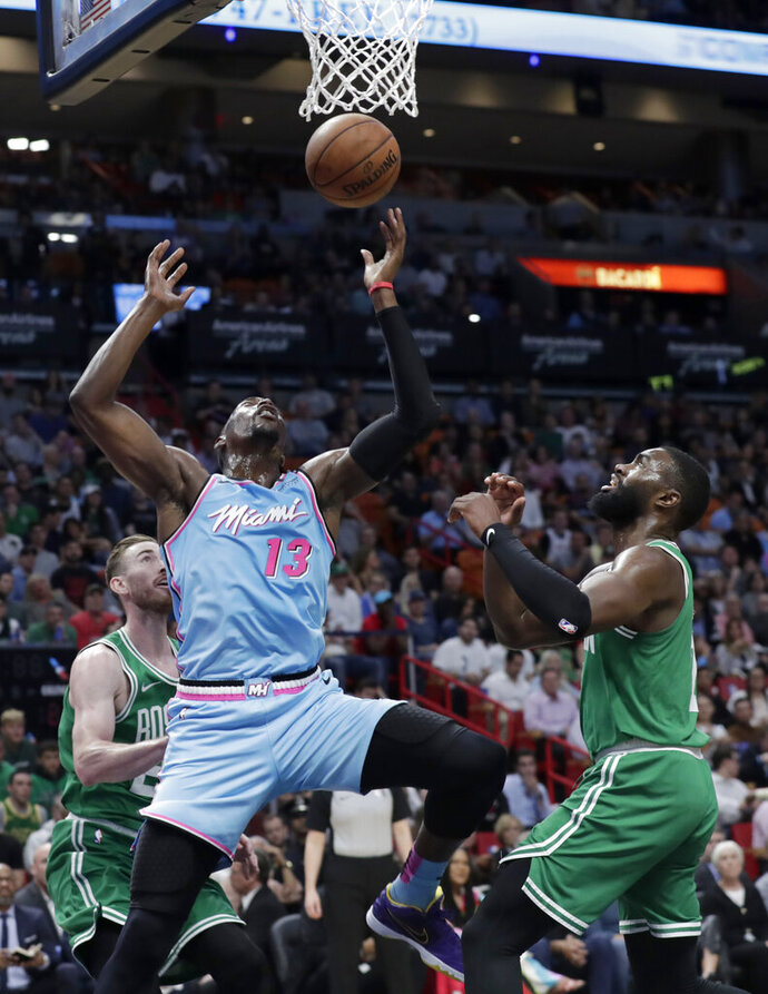 Miami Heat forward Bam Adebayo (13) goes to the basket as Boston Celtics forward Gordon Hayward, left, and guard Jaylen Brown defend during the first half of an NBA basketball game, Tuesday, Jan. 28, 2020, in Miami. (AP Photo/Lynne Sladky)