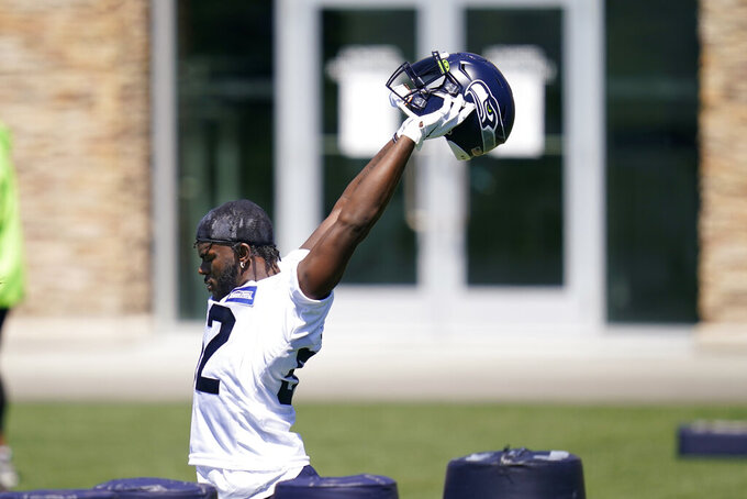 Seattle Seahawks' Darrell Taylor stretches during an NFL football rookie minicamp Friday, May 14, 2021, at the team's training facility in Renton, Wash. (AP Photo/Elaine Thompson)