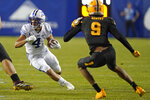 BYU running back Lopini Katoa (4) carries the ball as Arizona State linebacker Eric Gentry (9) defends in the second half during an NCAA college football game Saturday, Sept. 18, 2021, in Provo, Utah. (AP Photo/Rick Bowmer)