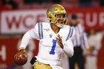 UCLA quarterback Dorian Thompson-Robinson (1) carries the ball against Utah in the first half during an NCAA college football game Saturday, Nov. 16, 2019, in Salt Lake City. (AP Photo/Rick Bowmer)
