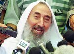 FILE - In this June 25, 1998 file photo, Sheik Ahmed Yassin, founder of the Islamic militant group Hamas, talks to the media during a celebration to welcome him back to Gaza, held at the Islamic complex in Gaza City.   Sheikh Ahmed Yassin was killed by a missile in his wheelchair after a prayer session in Gaza City.  Killings of major political and military figures have been a recurring factor in the modern Middle East, often presenting a defining moment and changing the contours of history in several instances. Whether carried out by a foreign or domestic attacker, the slayings,  including some high-profile assassinations — have had a huge, immediate and lasting impact. (AP Photo/Adel Hana, File)