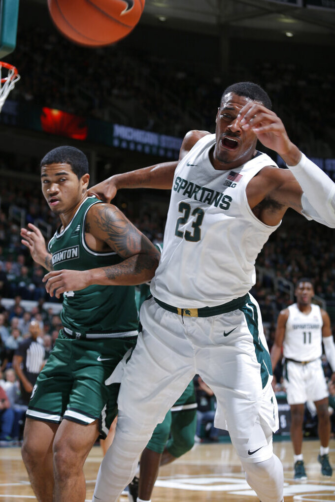 Michigan State's Xavier Tillman, right, and Binghamton's Sam Sessions vie for the ball during the first half of an NCAA college basketball game, Sunday, Nov. 10, 2019, in East Lansing, Mich. (AP Photo/Al Goldis)