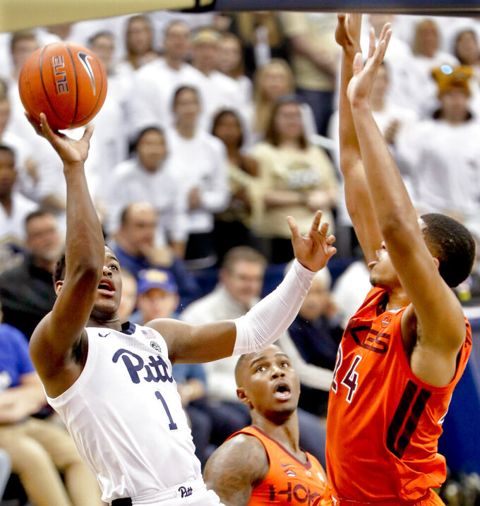Pittsburgh's Xavier Johnson (1) shoots over Virginia Tech's Kerry Blackshear Jr. (24) during the first half of an NCAA college basketball game, Saturday, Feb. 16, 2019, in Pittsburgh. (AP Photo/Keith Srakocic)