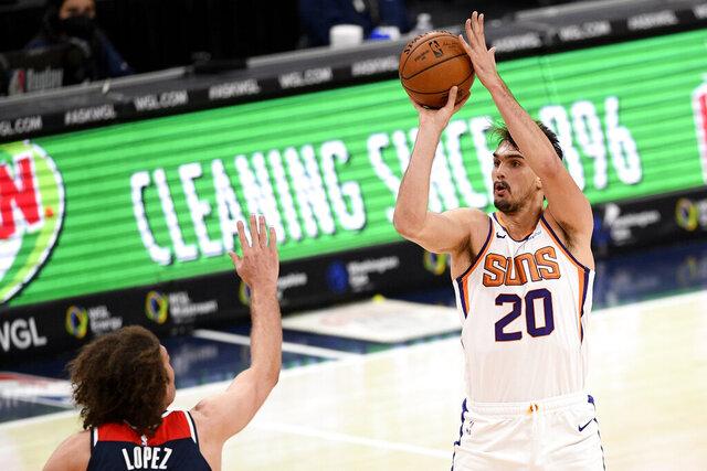 Phoenix Suns forward Dario Saric (20) shoots against Washington Wizards center Robin Lopez, left, during the first half of an NBA basketball game, Monday, Jan. 11, 2021, in Washington. (AP Photo/Nick Wass)