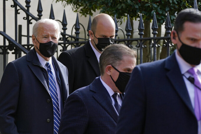 President Joe Biden departs after attending mass at Holy Trinity Catholic Church, Sunday, Jan. 24, 2021, in the Georgetown neighborhood of Washington. (AP Photo/Patrick Semansky)