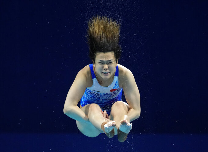 Shi Tingmao of China competes in women's diving 3m springboard preliminary at the Tokyo Aquatics Centre at the 2020 Summer Olympics, Friday, July 30, 2021, in Tokyo, Japan. (AP Photo/Dmitri Lovetsky)