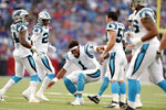 Carolina Panthers quarterback Cam Newton, center, jokes with teammates after linebacker Shaq Green-Thompson, far left, intercepted a pass from Buffalo Bills quarterback Nathan Peterman (not pictured) during the first half of an NFL football game, Thursday, Aug. 9, 2018, in Orchard Park, N.Y. (AP Photo/Adrian Kraus)