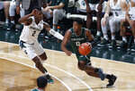 Binghamton's Richard Caldwell Jr., right, drives against Michigan State's Rocket Watts during the first half of an NCAA college basketball game, Sunday, Nov. 10, 2019, in East Lansing, Mich. (AP Photo/Al Goldis)