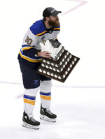 St. Louis Blues' Ryan O'Reilly skates with the Conn Smythe trophy after the Blues' win over the Boston Bruins in Game 7 of the NHL hockey Stanley Cup Final, Wednesday, June 12, 2019, in Boston. (AP Photo/Charles Krupa)