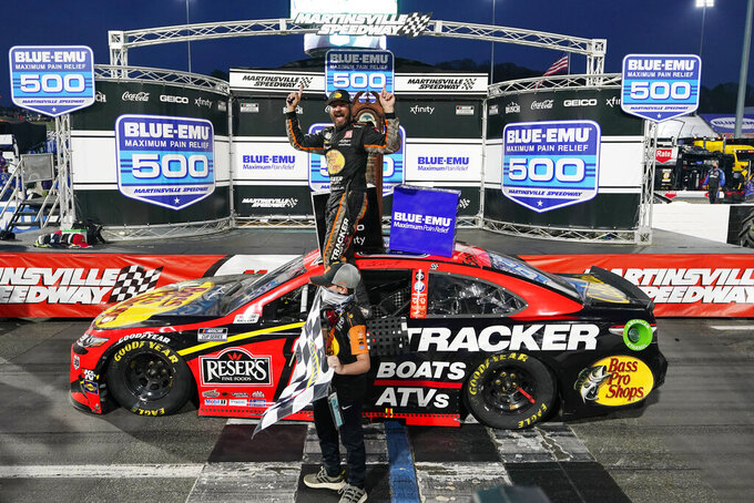 Truex outlasts teammate Hamlin to win again at Martinsville