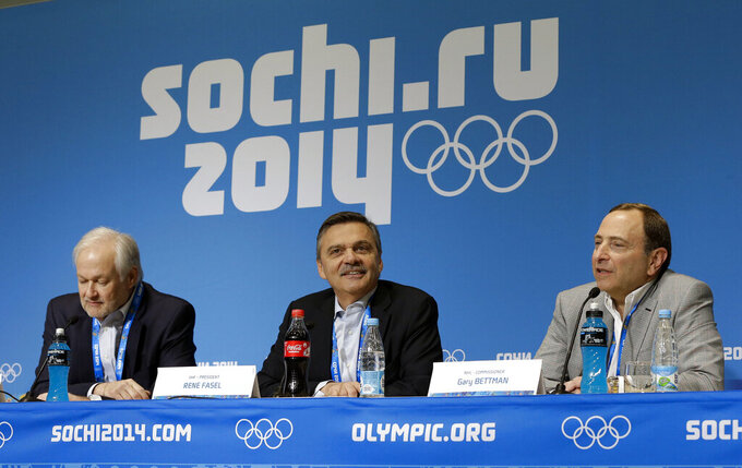 FILE - In this Feb. 18, 2014, file photo, NHL Players' Association Executive Director Don Fehr, left, International Ice Hockey Federation President Rene Fasel, center, and NHL Commissioner Gary Bettman, right, answer questions during a news conference at the 2014 Winter Olympics in Sochi, Russia. National Hockey League players are set to return to the Olympics in Beijing this winter after reaching an agreement with international officials. The league, NHLPA, International Olympic Committee and International Ice Hockey Federation struck a deal Friday, Sept. 3, 2021, that will put the best players in the world back on sports' biggest stage in February after skipping the 2018 Winter Games in South Korea. (AP Photo/Mark Humphrey, File)