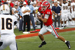 Georgia quarterback Stetson Bennett (13) drives in for a touchdown against Murray State in the second half of an NCAA college football game Saturday, Sept. 7, 2019, in Athens, Ga. (Joshua L. Jones/Athens Banner-Herald via AP)